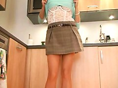 British slut Sandie Caine fingers herself in the kitchen