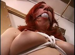 Smoking hot redhead bound and gagged for a BDSM session