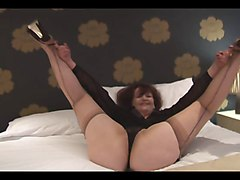 Busty Mature In Seamed Nylons Fingering On The Bed